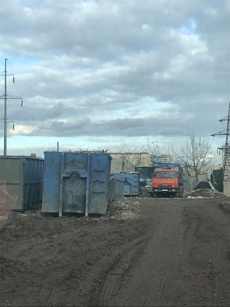 Вывоз мусора контейнером 27 м3 цена